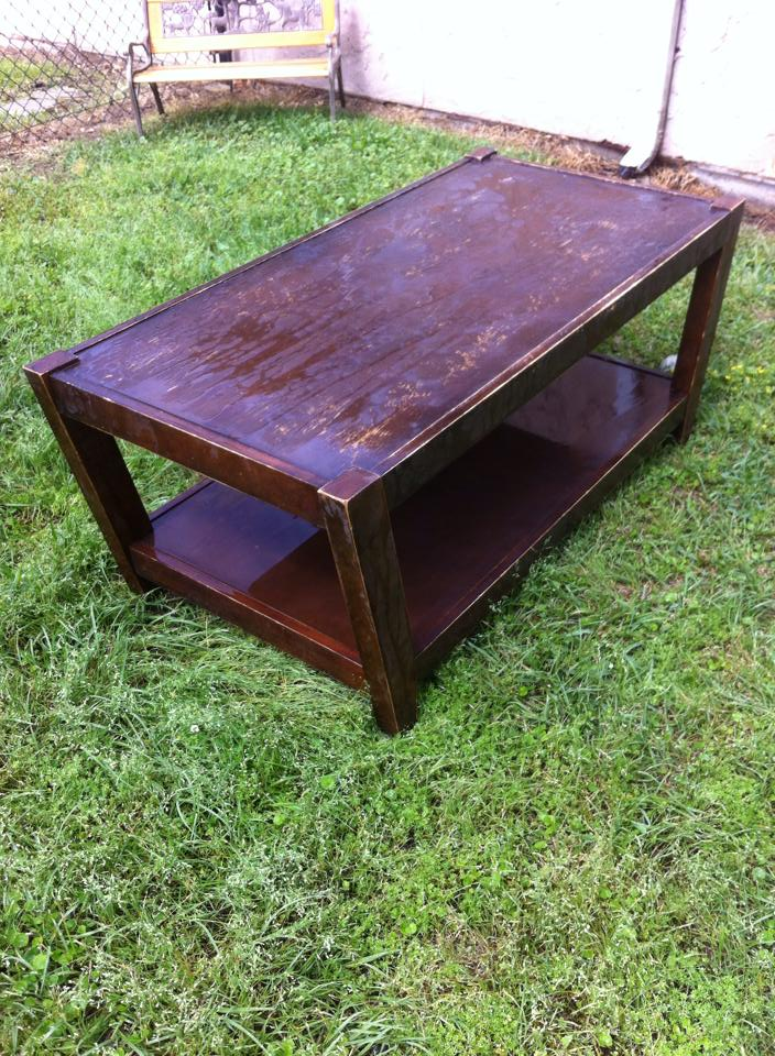Before picture of the wooden coffee table.