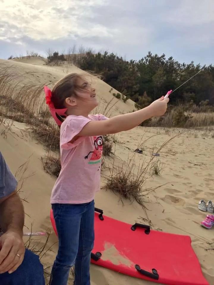 Flying a kite at Jockey's Ridge State Park.