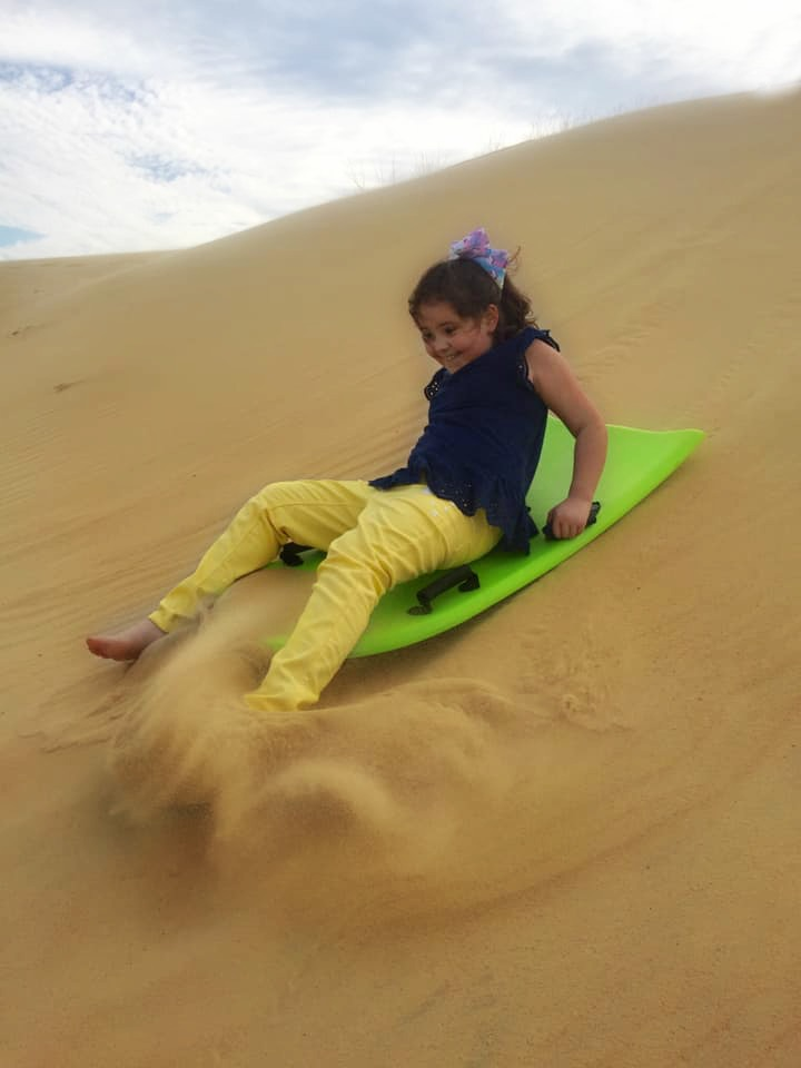 Sand sledding at Jockey's Ridge was the most fun we had in the Outer Banks! | Finding Mandee