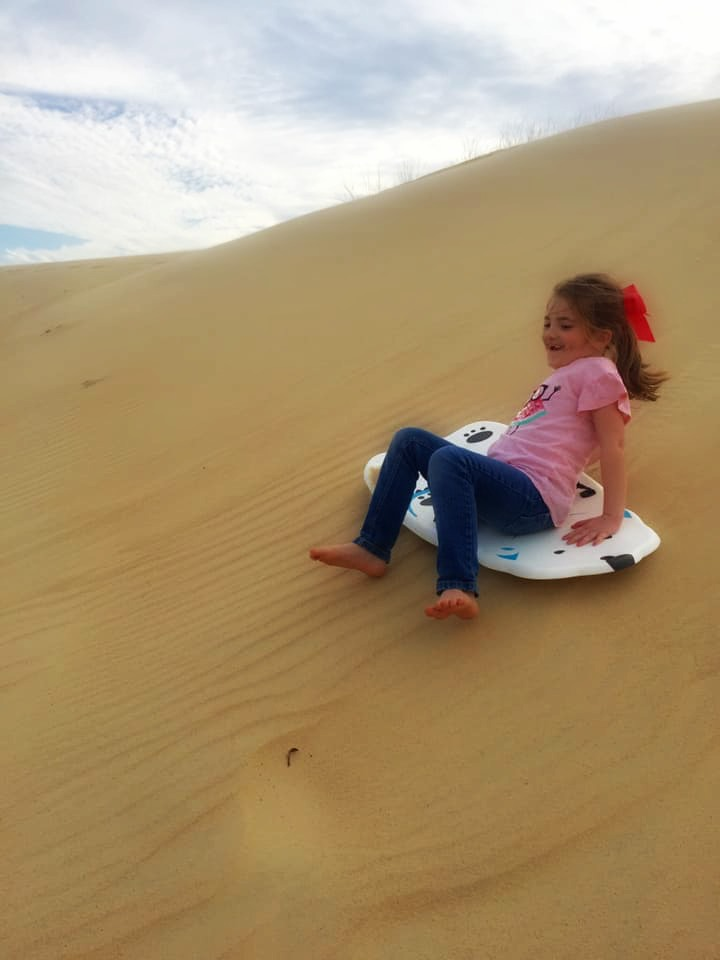 Dune sledding at Jockey's Ridge State Park was our favorite part of our trip to the Outer Banks. | Finding Mandee