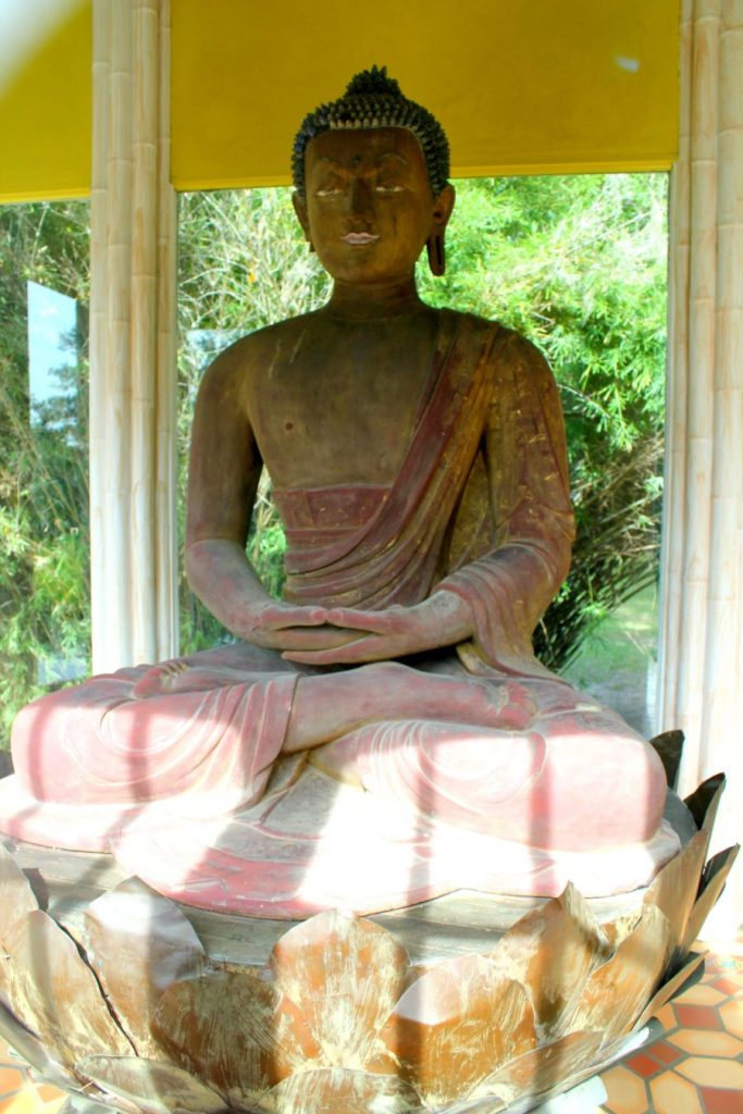 The 900-year-old Buddha statue at Jungle Gardens in Louisiana.