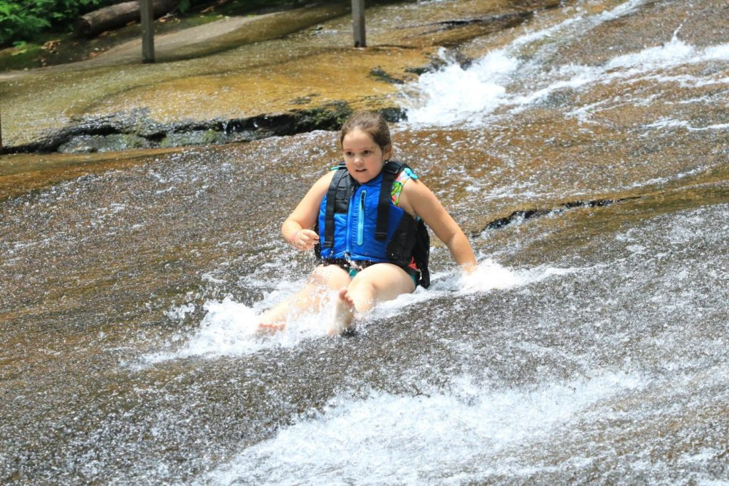 Going down a natural water slide.