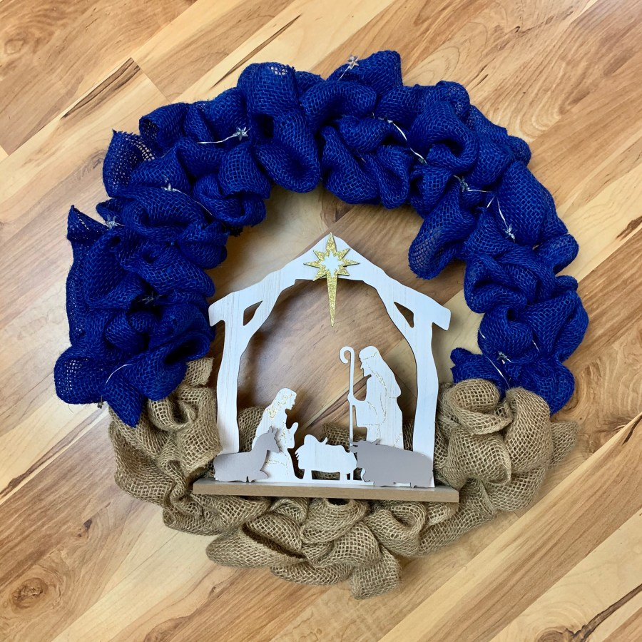 Step 5: Add the Nativity scene to the wreath.