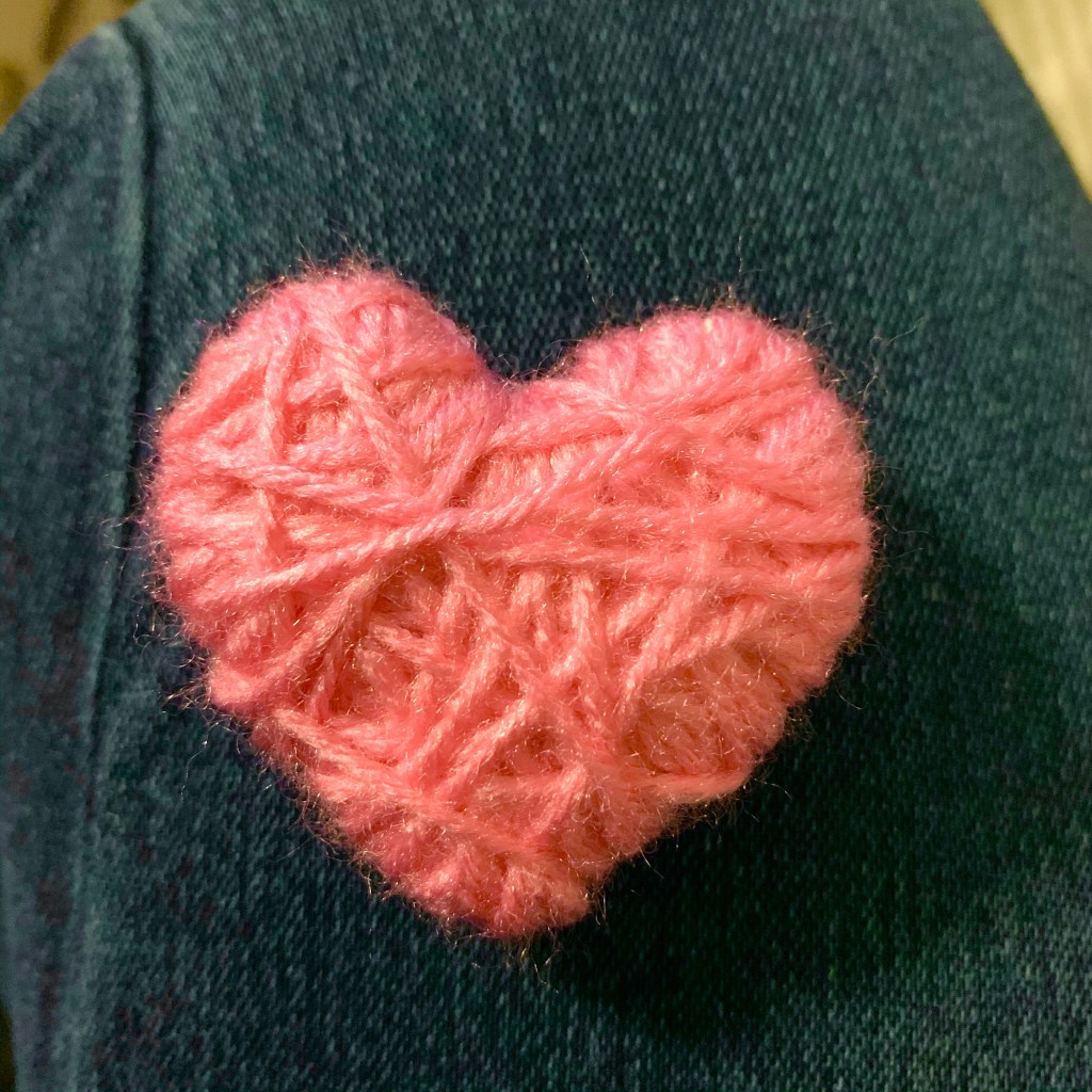 Yarn wrapped heart for Valentine's Day wreath.