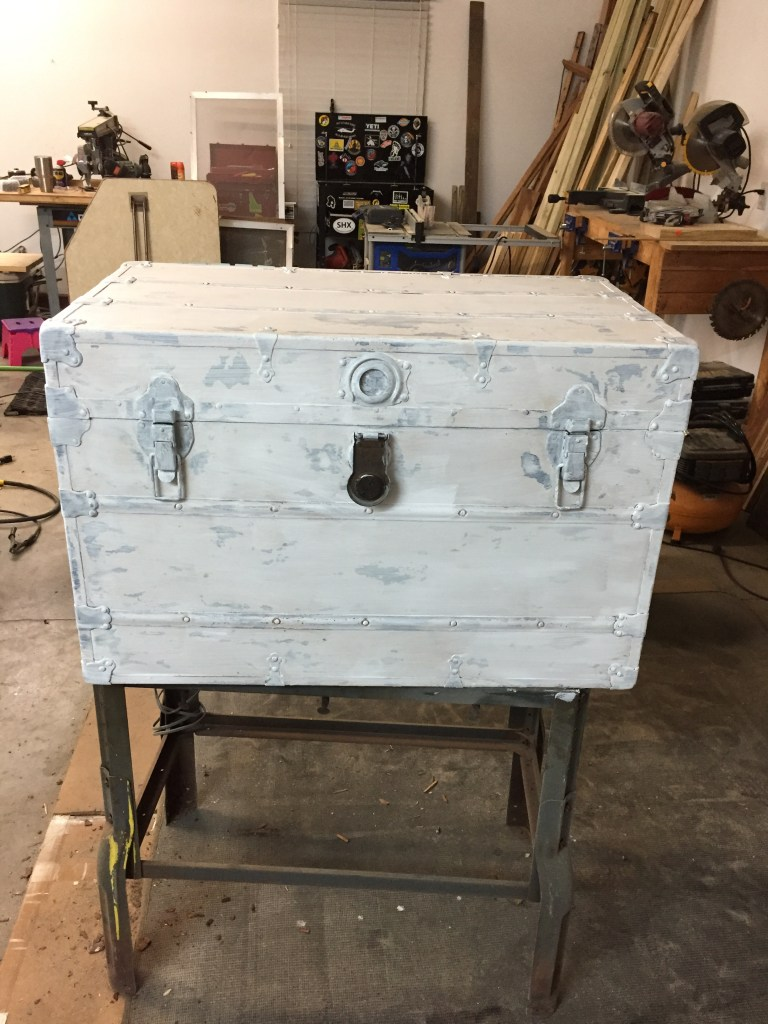 Step 3 of refurbishing our vintage trunk was to add 2 coats of primer.