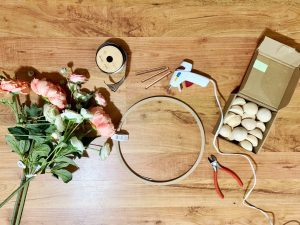 Gather your supplies for your DIY wood bead wreath.