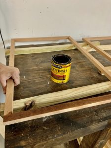 Staining the picture frame.