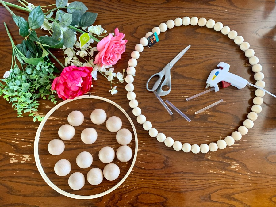 Supplies for the DIY wood bead Easter wreath.