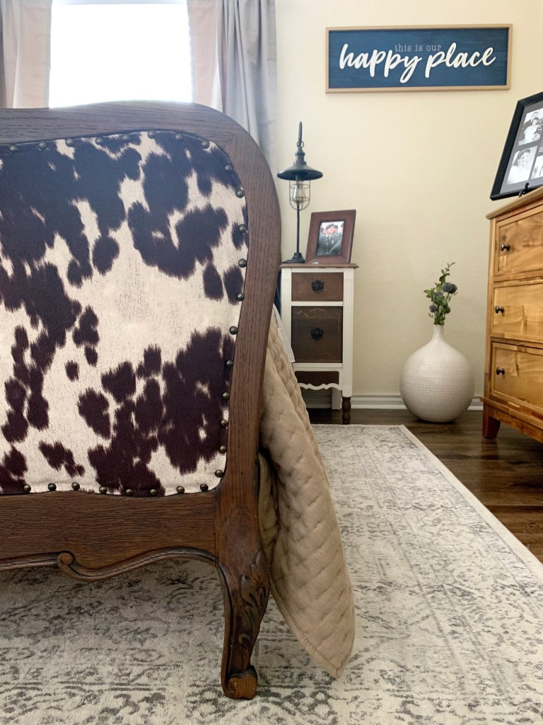 Our refurbished antique wood and upholstery bed.