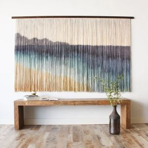 Large pieces of wall art are perfect for filling blank walls.