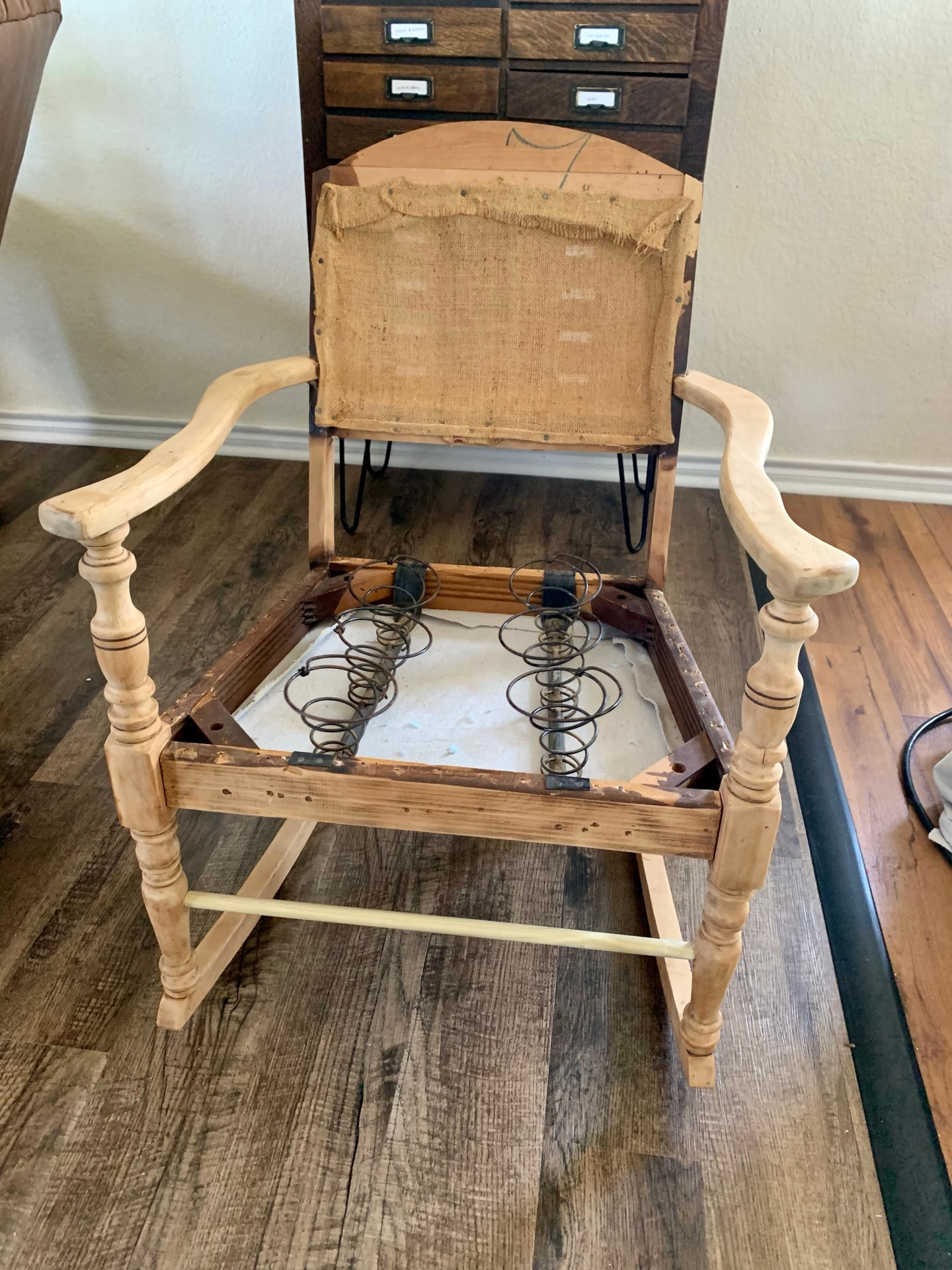 Refurbishing an antique rocking chair.
