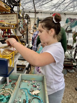 Girl shopping at the flea market in Round Top, Texas.