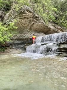 Playing in the waterfall in Belton, Texas.