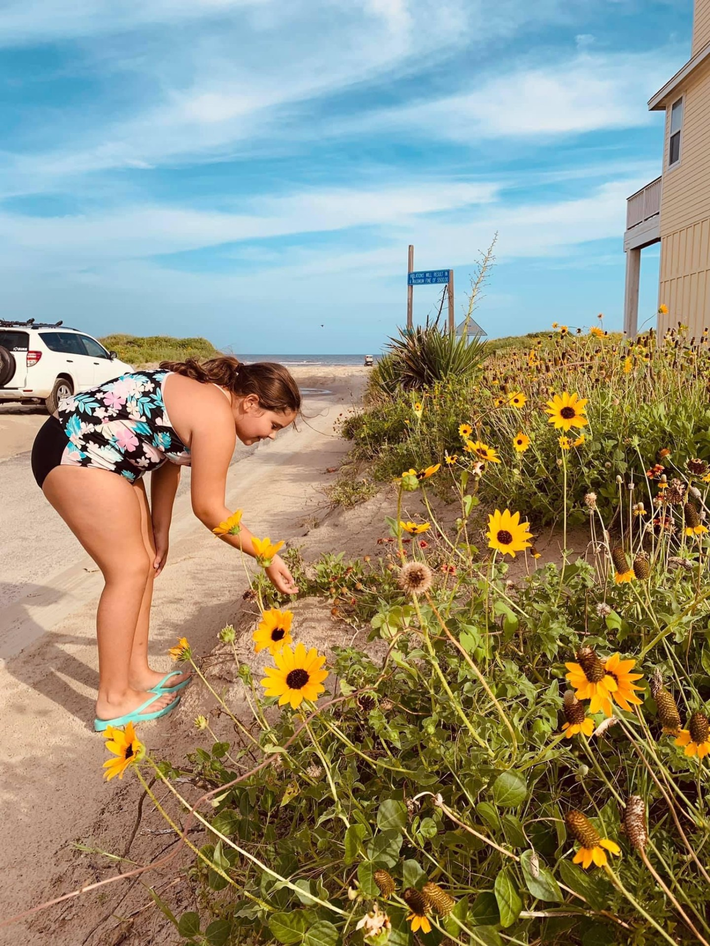 Taking the time to stop and smell the flowers at the beach.