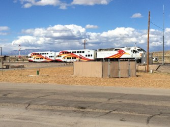 Rail Runner at rail crossing - great paint scheme!