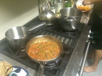 Working the burners. That red sauce smelled insanely good!
