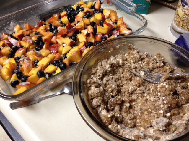 healthy peach crisp with blueberries and streusel
