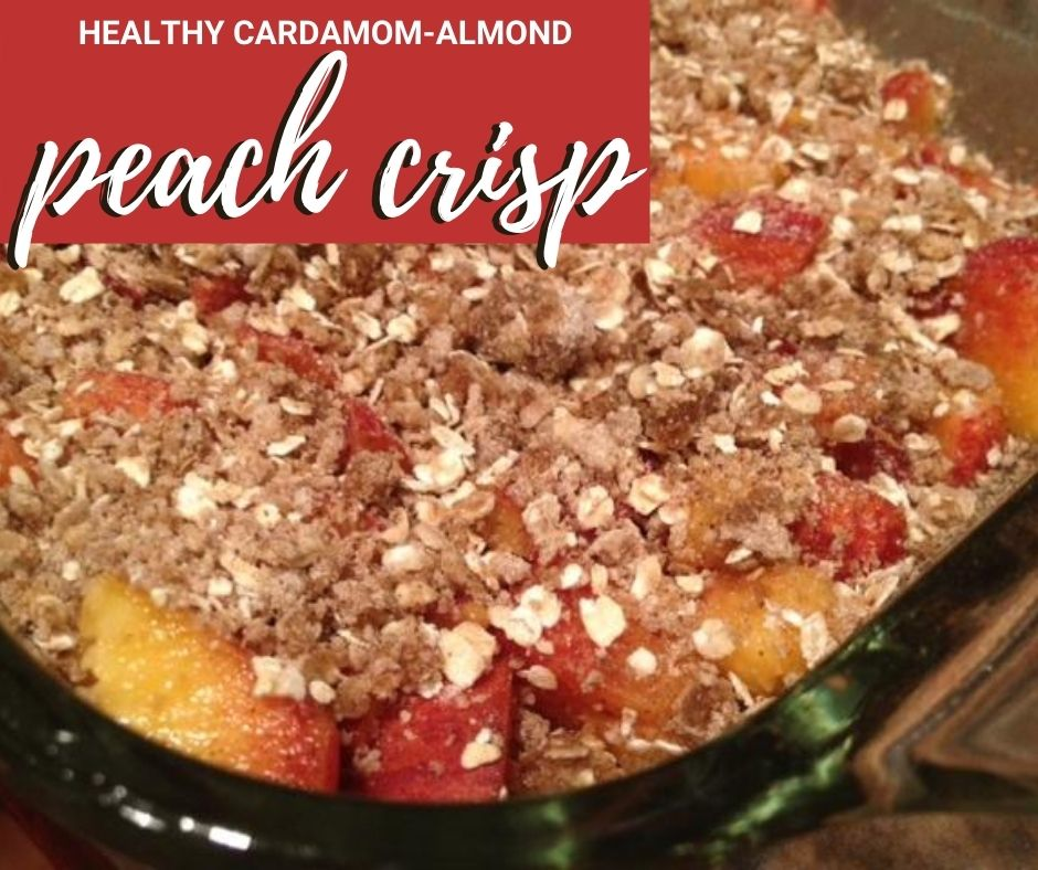 Healthy Cardamom-Almond Peach Crisp | This super delicious and easy peach crisp recipe is a twist on the classic, with the addition of ground cardamom and almond extract.  So healthy you can eat it for breakfast, perfect any day!