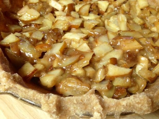 caramel pear pie oat crumble pears in crust closeup