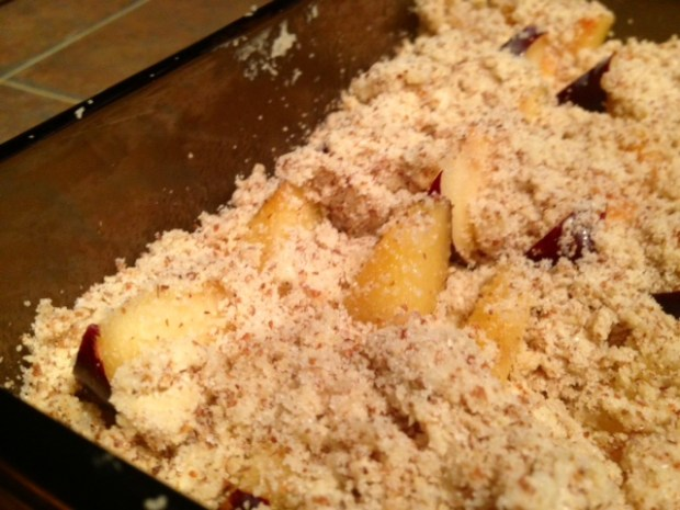 fluffy plum cake with almond crumble assembled closeup