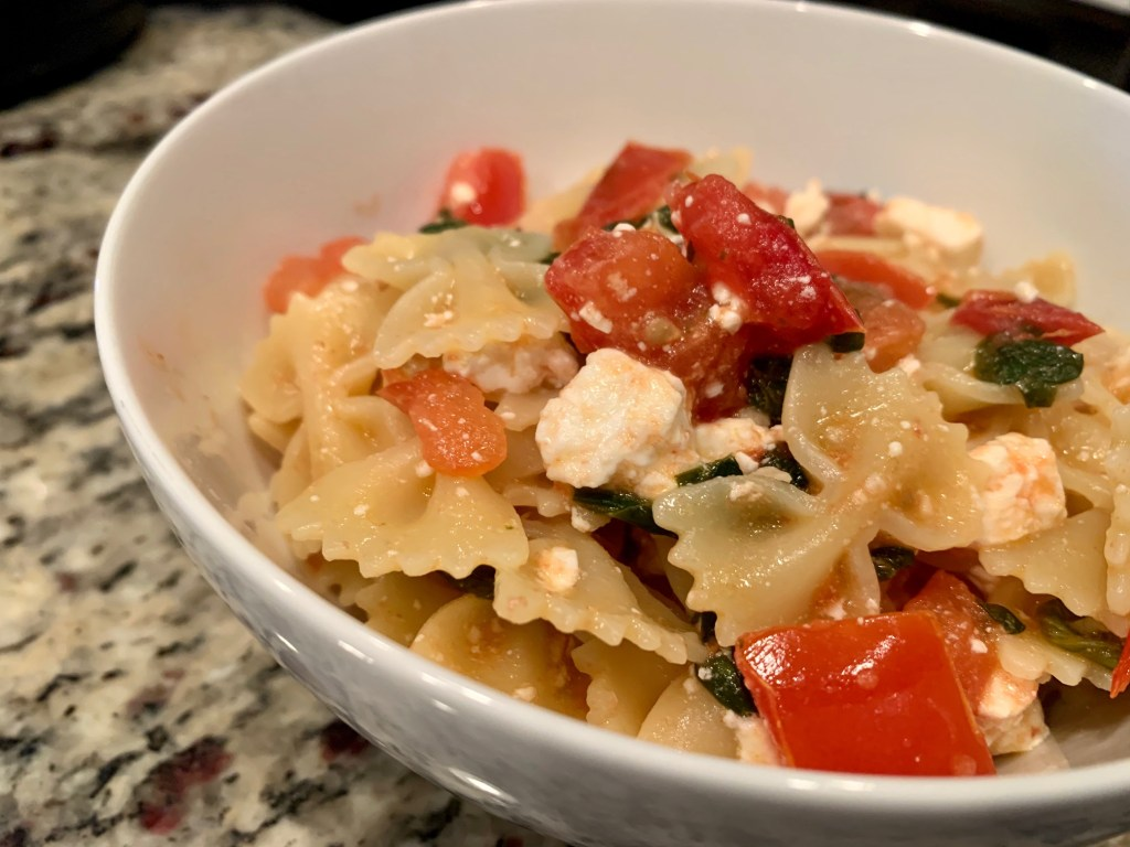 Pasta with Spinach, Tomatoes, & Feta | This super easy vegetarian pasta makes the perfect weeknight dinner, on the table in less than half an hour! This was my go-to meal for years. Easy pasta recipe, Meatless Monday. #pasta #vegetarian #feta #meatlessmonday