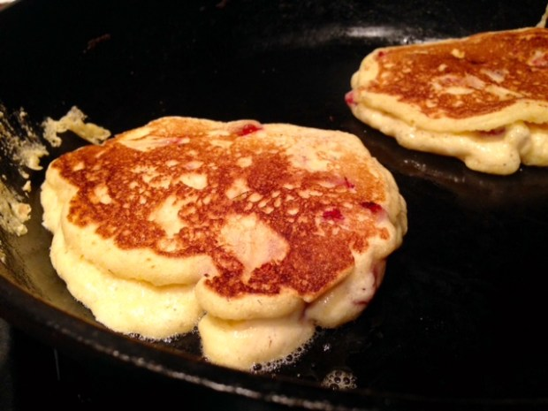 strawberry cornmeal griddle cakes flipped closeup