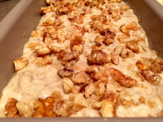 bourbon vanilla banana bread with candied walnuts assembled closeup