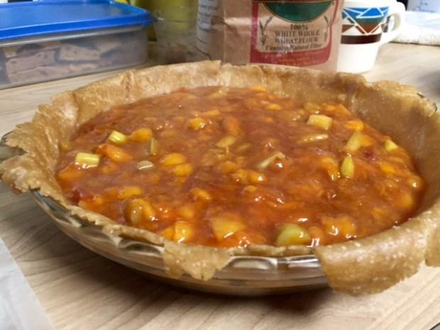 peach rhubarb pie filling in pie