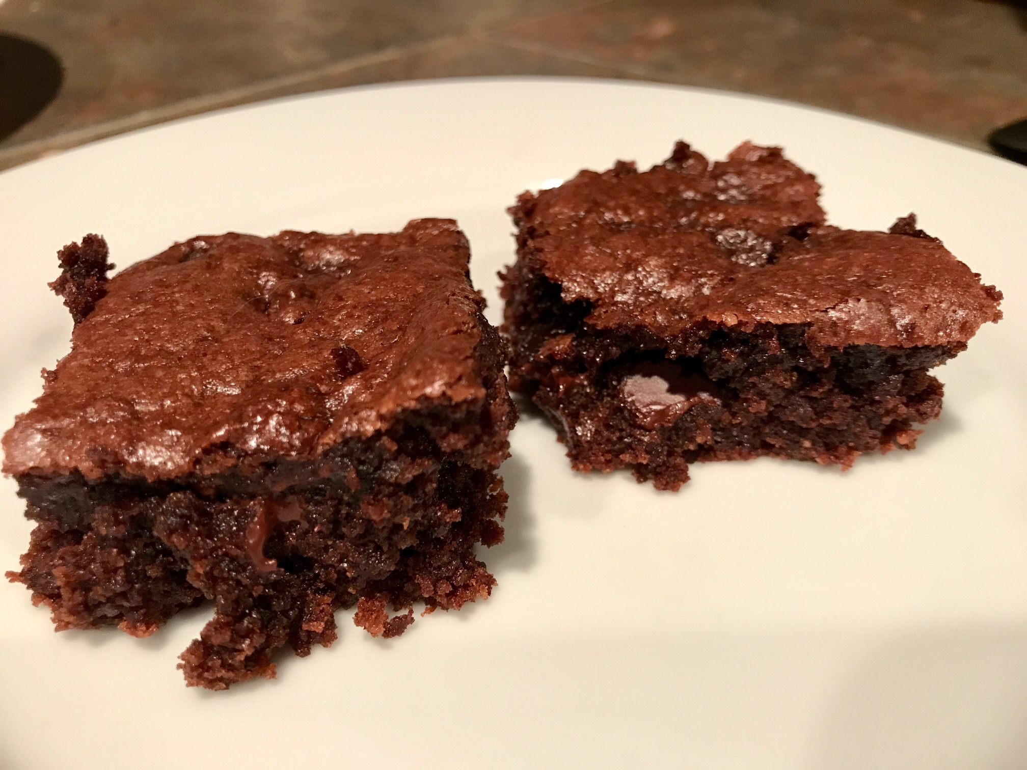 Tahini Brownies...delicious, easy brownie recipe made with tahini (sesame seed paste), can easily be made gluten-free, dairy-free, etc.   Tahini is a food used frequently in Middle Eastern cuisine in both sweet & savory ways. Easy brownie recipes, gluten-free desserts. #brownies #tahini #desserts #recipes