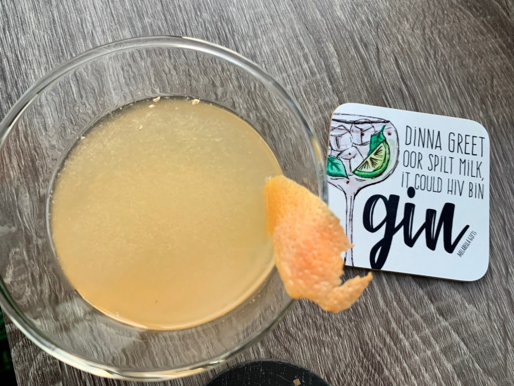 bohemian cocktail from above with a fun gin coaster