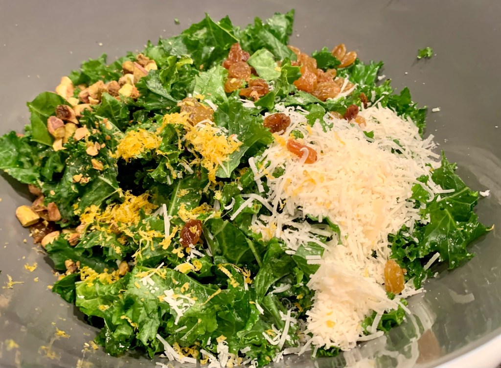 For this easy kale salad, just toss the kale with parmesan, lemon zest, golden raisins, and pistachios, then dress