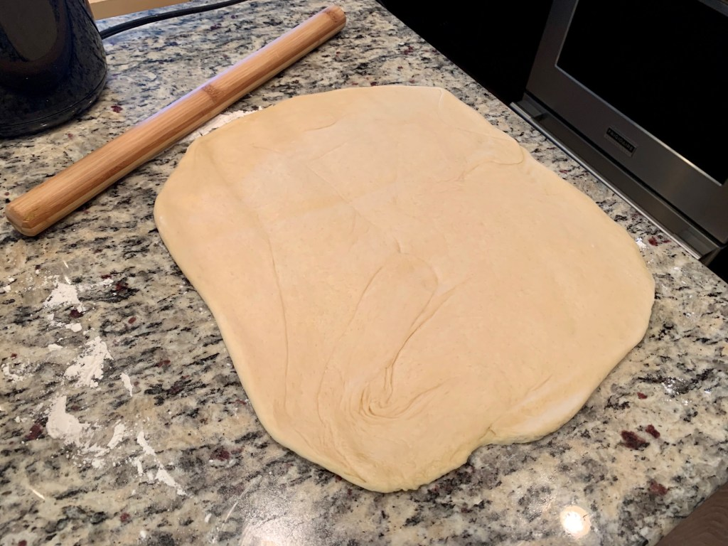 Soft dough rolled out for the babka