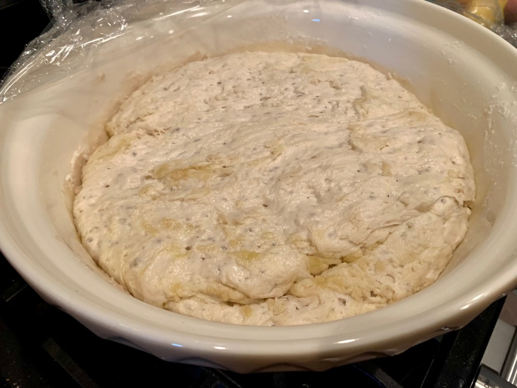 Ligurian focaccia dough risen and ready to put in the pan
