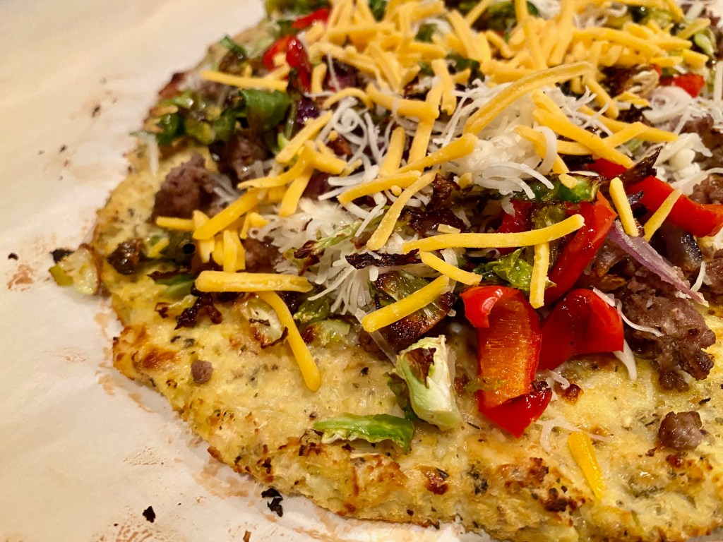 You can top your cauliflower crust pizza with whatever you want, but make sure it's not soggy