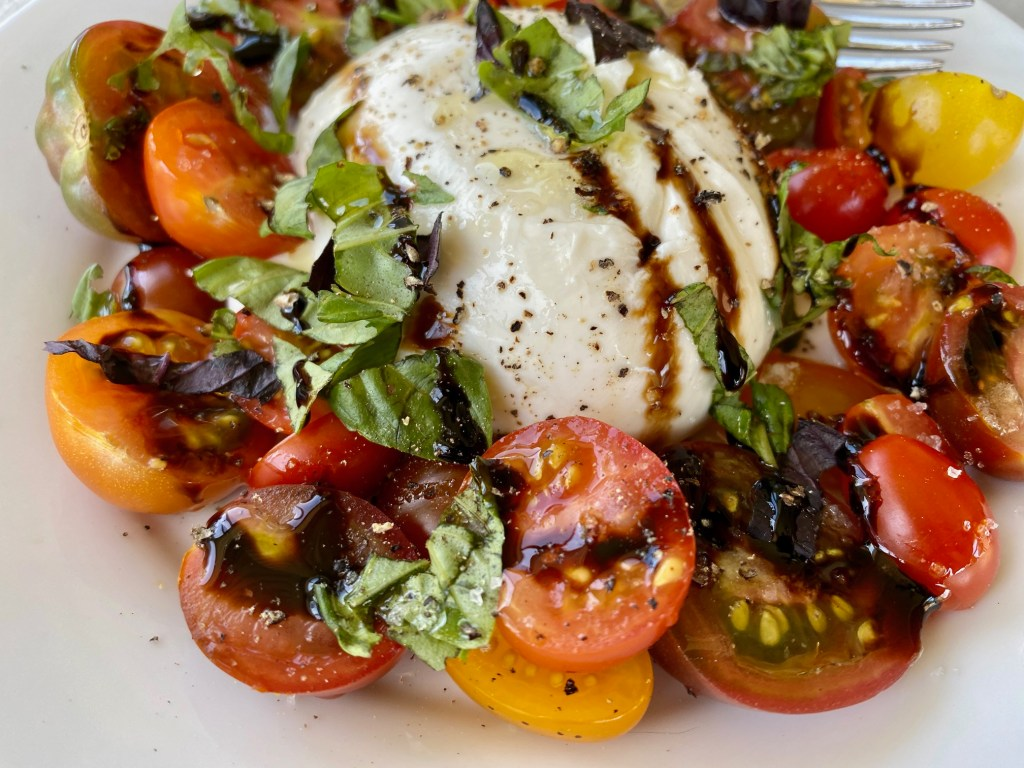 The Best Burrata Caprese Salad | If you're using boring mozzarella in your caprese, I've got news for you! Caprese salad with burrata is so much better! It's easy, delicious, & doesn't require your stove or oven--a perfect summer side dish, made with simple and high-quality ingredients. What to do with burrata cheese! #burrata #caprese #sidedish #summerrecipe