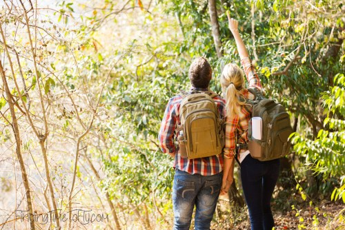 young couple hiking in autumn mountain