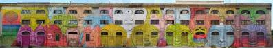 Blu transformed a 48 Windowed building in Rome into a beautiful 27 multicolour-faced mural