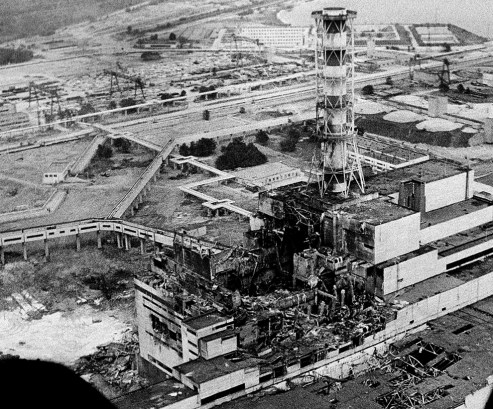 The Chernobyl nuclear power plant sits crippled two to three days after the explosion in Chernobyl, Ukraine in April, 1986. In front of the chimney is the destroyed 4th reactor.