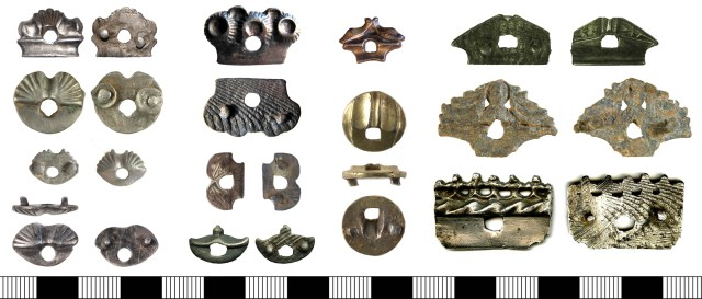Enigmatic items that appear to be catch-pieces from dress fasteners.