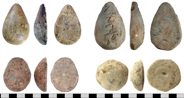 Lead objects which might be ingots, weights or palm guards. Top left: DENO-8B95FD. Top right: SUSS-3D9994. Bottom left: KENT-8A5321. Bottom right: SWYOR-5BC2A7.