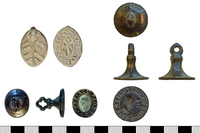 Medieval seal matrices. Left above, a flat pointed-oval lead matrix (SF-3FC3B3). Left below, a conical silver matrix with a re-used Roman intaglio (SUR-36D8C9) - note the orientation mark on the reverse. Right, a conical copper-alloy matrix with circular die (NARC-BDC51E).