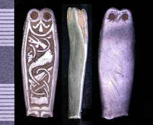 Early medieval silver strap-end with animal decoration