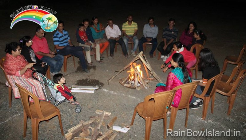 cold night campfire at rainbow island resort near pune