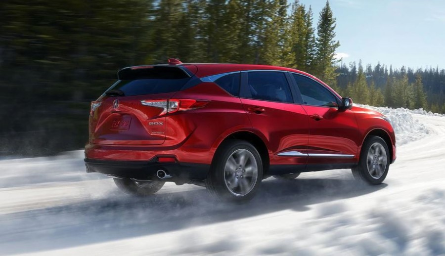2021 Acura RDX Red Color Exterior Running On The Snowing Road