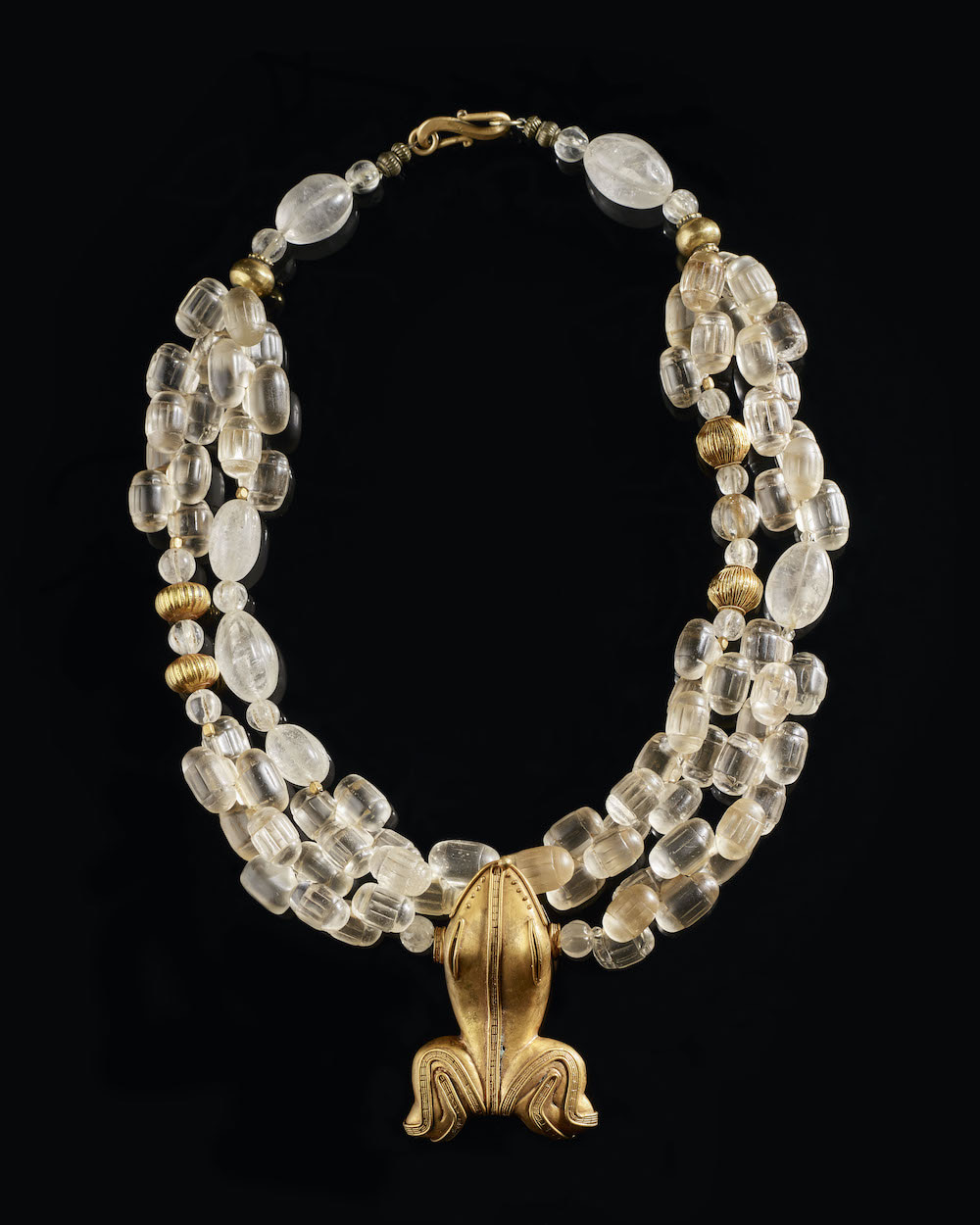 """Bohemian crystal from the 19th Century, rock crystal from Himalaya, huge zoomorphic bead from Colombia called """"tumbaga"""" which is an allow of copper, silver and gold"""