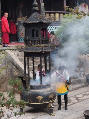 Two Naxi women, blinded by the smoke of their offering to SanDuo.