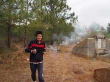 Ji Yu running from the fireworks he just lit. No bad spirits around here no more!