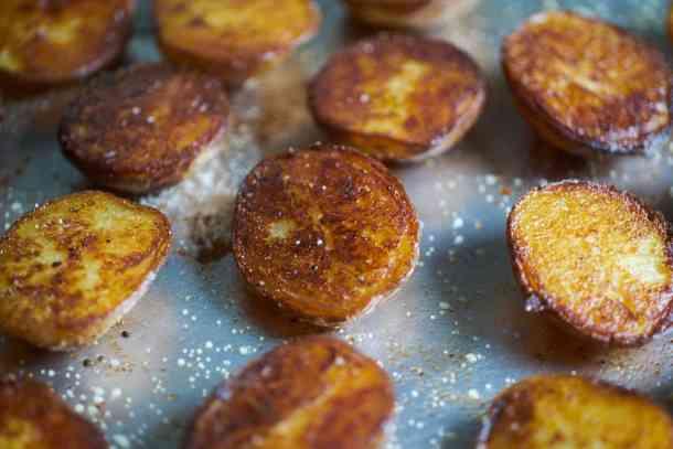 Crispy roasted potatoes on a sheet tray.