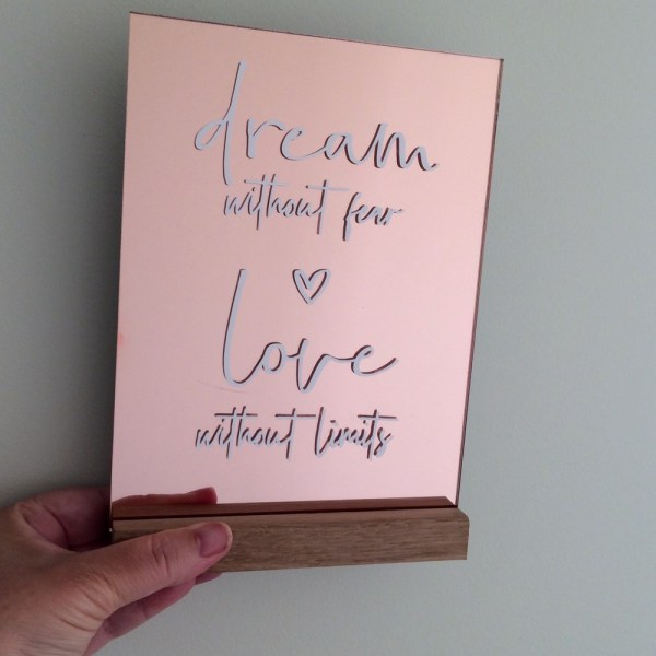 mirror rose gold sign