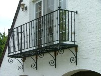 Belly Bar and Knuckle Wrought Iron Balcony